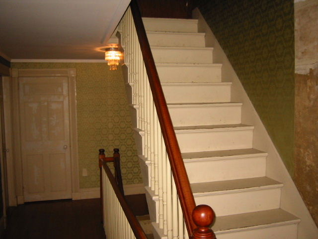 Stairs To The Attic. Note The Plywood Trap Door At The Top.